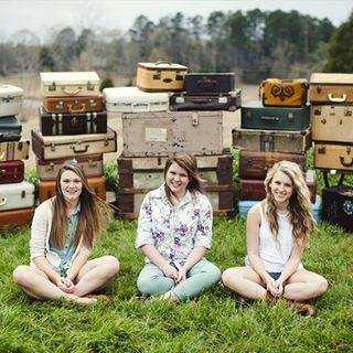Suitcases-with-girls1-720x720